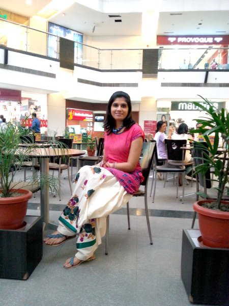 Off beat Patiala salwaar with colorful flowers complementing the pink tunic.