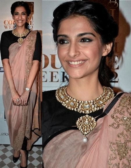 Sonam Kapoor looking drop dead gorgeous in Anamika Khanna pant saree.