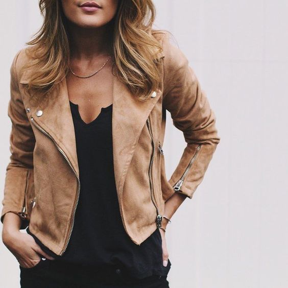 Happiness is wearing your favorite leather jacket!