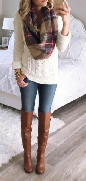 Tan boots look so classy and make a huge style sttatement... Source - popsu.gr