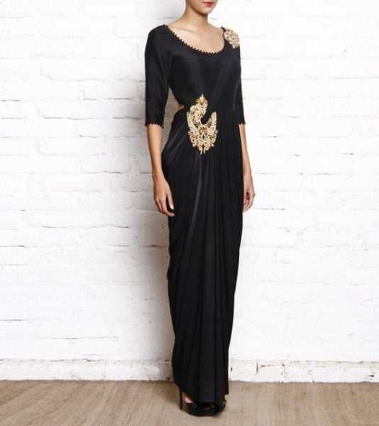 Flaunt this stunning black saree gown at a reception and be ready to get bags full of compliments. Source - indianroots.com