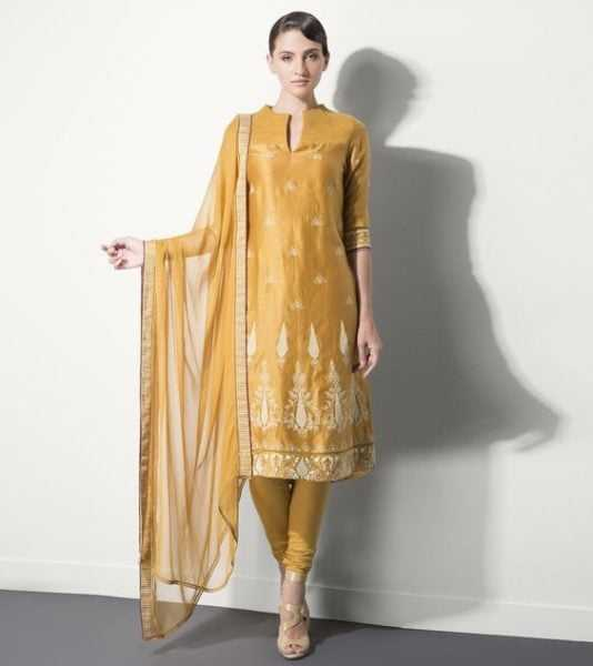 This monotone mustard beauty is classic and will make a great outfit for mehndi function. Source - indianroots.com