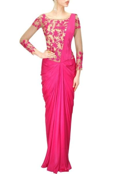 A bold bright colored saree gown to add up the festive feel. Source - panachehautecouture
